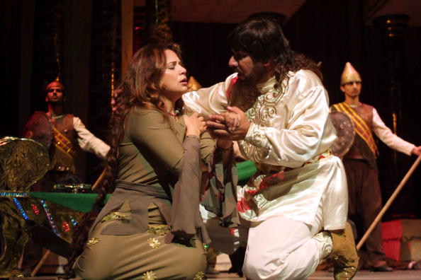 "AMMAN, JORDAN - SEPTEMBER 10: Iraqi actors perform ""Zabibah and the King,"" a play based on a novel written by Iraqi President Saddam Hussein, at the al-Hussein Culture Center September 10, 2002 in Amman, Jordan. The play is about a relationship between a king and a woman named Zabibah, symbolizing the ""love affair"" between Saddam and the Iraqi people. (Photo by Salah Malkawi/Getty Images)"